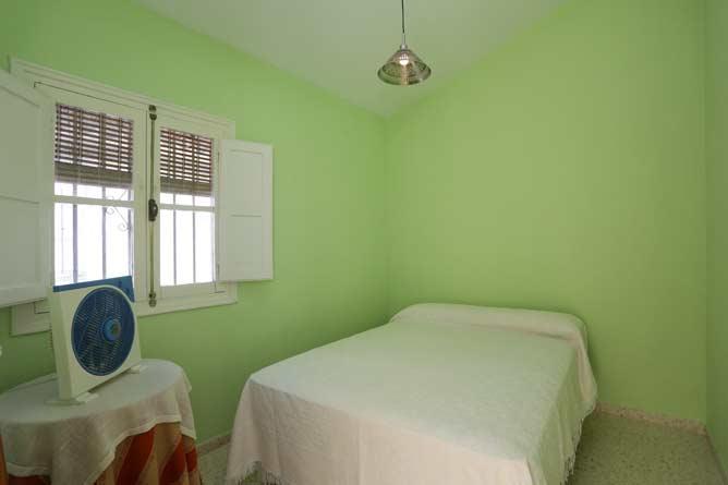 Dormitorio y ventana
